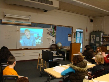 Students participate in a video conference learning session with Observatory sta