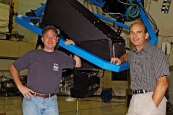 Instrument-building astronomers Gary Hill (left) and Phillip MacQueen pose with