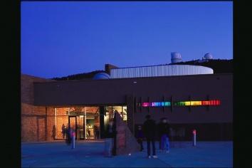 The Frank N. Bash Visitors Center at McDonald Observatory at dusk.