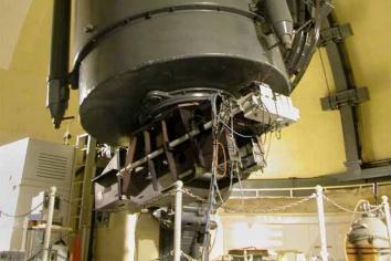 The Sandiford Cassegrain Eschelle Spectrometer (bottom) is shown here mated to t