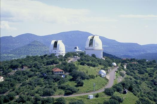 The two large domes in the foreground house the 2.1-meter (82-inch) Otto Struve