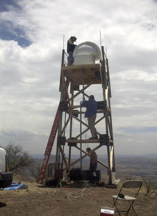 University of New Mexico research faculty members and a student install a fully