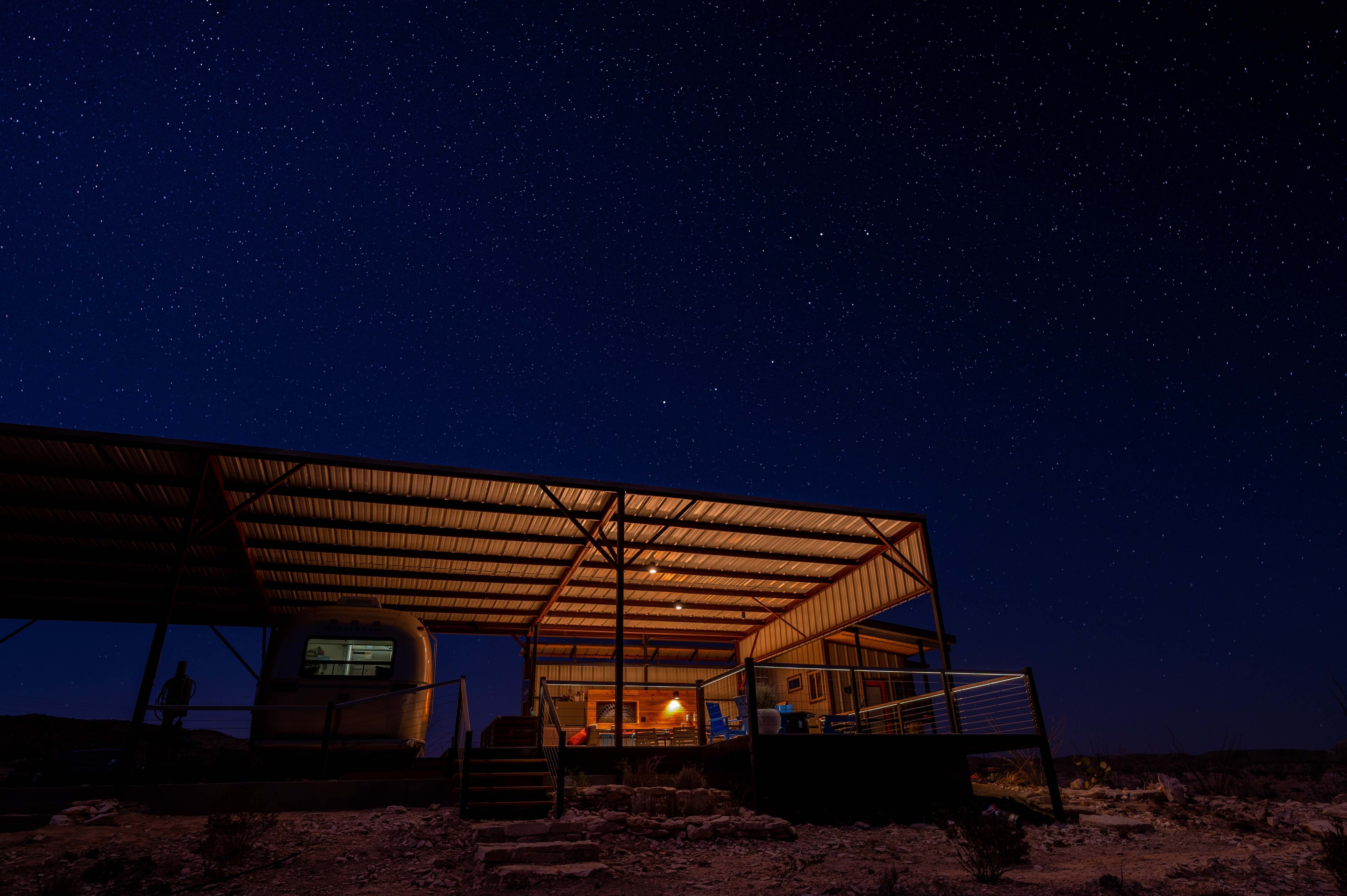 Big Bend Stargazer trailer under awning with nigh-sky friendly lights in Terlingua, Texas. photo by Stephen Hummel / McDonald Observatory.