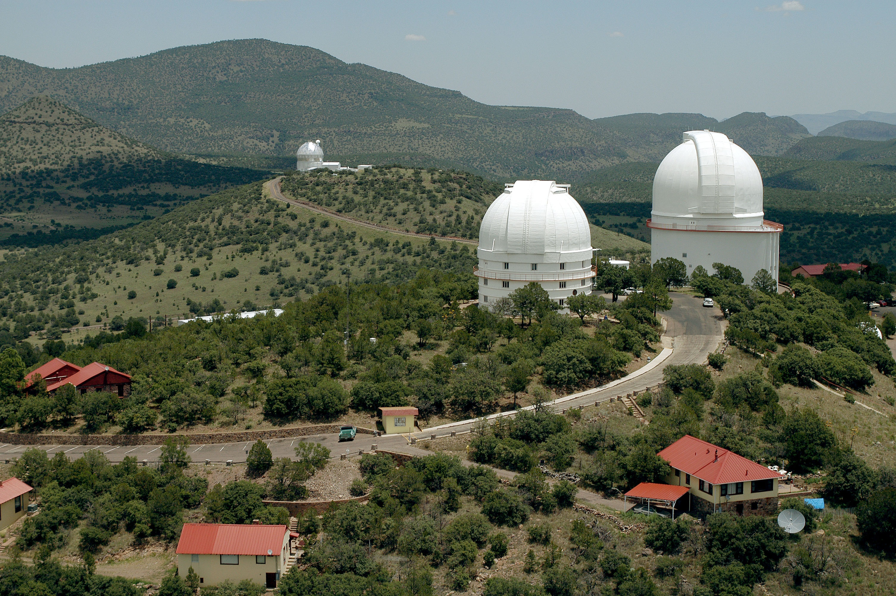 Aerial view of the large telescope domes of McDonald Observatory.